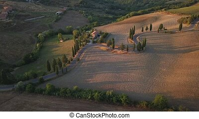 Curved or drunk road in Tuscany, Italy aerial lndscape