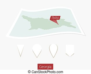 Curved paper map of Georgia with capital Tbilisi on Gray Background. Four different Map pin set.