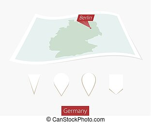 Curved paper map of Germany with capital Berlin on Gray Background. Four different Map pin set.