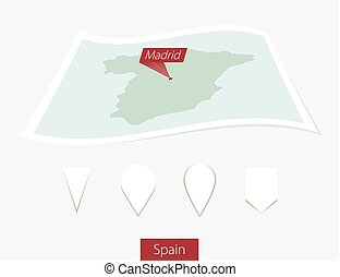 Curved paper map of Spain with capital Madrid on Gray Background. Four different Map pin set.