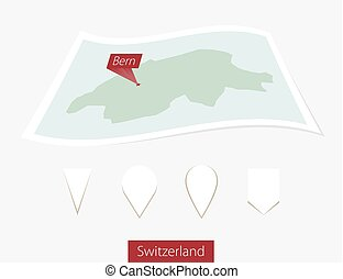 Curved paper map of Switzerland with capital Bern on Gray Background. Four different Map pin set.