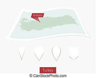 Curved paper map of Turkey with capital Ankara on Gray Background. Four different Map pin set.