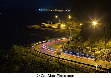 curved road by the sea.