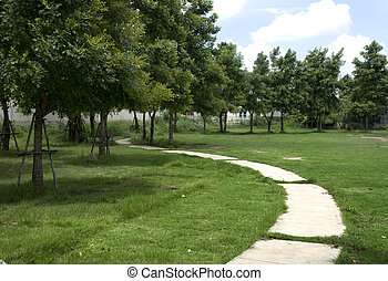 Curved road in the grass