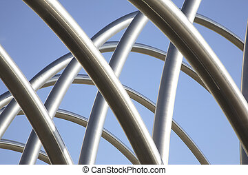 Curved Stainless Steel Tubes and Blue Sky