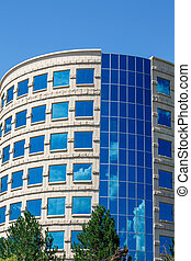 Curved Stone and Blue Glass Office Tower