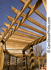 Curved Walkway Trellis - A wooden trellis curving over a...