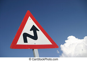 Curves Ahead - Warning sign of curves in the road