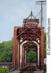 Curving Railroad Tracks Cross Bridge - Railroad tracks curve...