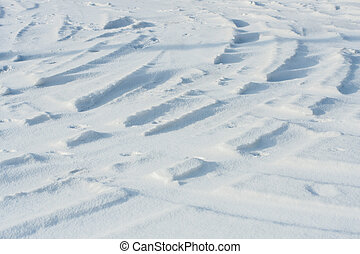 Curvy car tracks in the snow background