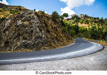 Curvy mountain road in Mediterranean mountains, getting off