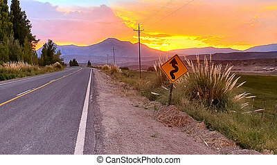 curvy road at sunset on the mountain