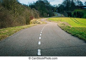 Curvy road in the countryside - Curvy asphalt road in a...