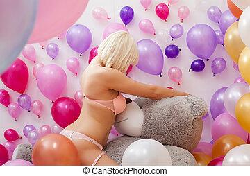 Curvy young blonde posing hugging teddy bear - Image of...