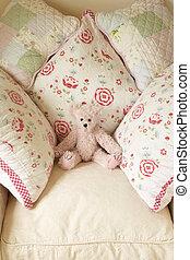 Cushions On Chair With Teddy Bear
