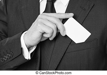 Custom debit card design. Male hand put plastic blank white card to pocket classic suit jacket. Business man carries credit card. Banking services for business. Custom design making your card unique