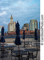 Custom House Tower and cafe with umbrellas in Boston