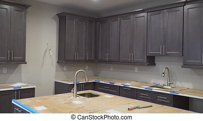 Custom kitchen cabinets in various stages of installation...