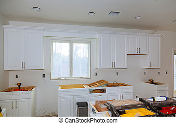 Custom kitchen cabinets of installation base for island in center