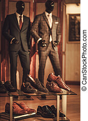Custom made shoes and suits in tailor studio.