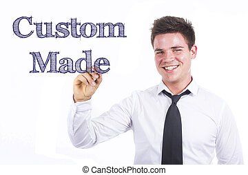 Custom Made - Young smiling businessman writing on transparent surface