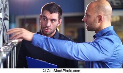 customer and salesman at car service or auto store -...