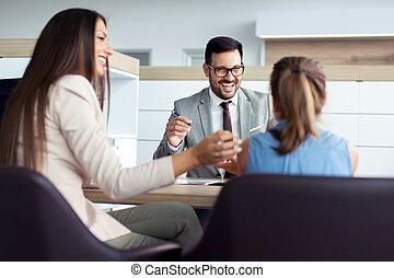 Customer buying a car at dealership