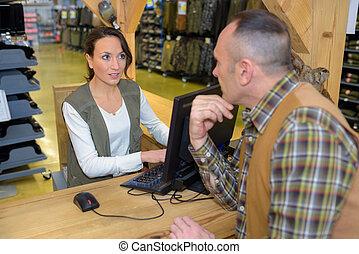 customer buying at at hardware store