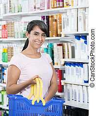 Customer Buying Cosmetics In Pharmacy