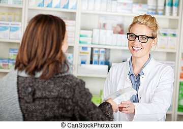 Customer Buying Medicine In Pharmacy - Female customer...