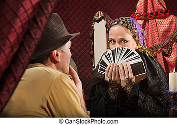 Customer Chooses a Tarot Card