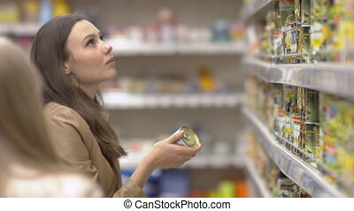 Customer chooses the delicious canned olives - Customer...