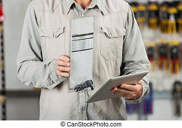 Customer Examining Product Through Tablet Computer