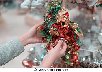 customer girl choosing Christmas tree or New Year's...