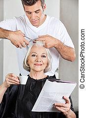 Customer Having Haircut At Parlor