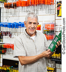 Customer Holding Packed Product In Hardware Shop