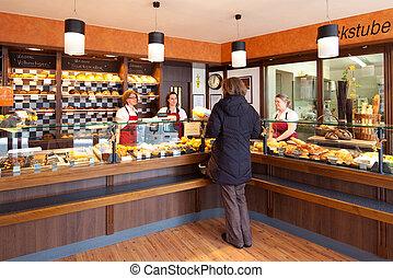 Customer in a modern bakery