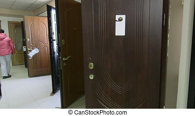 Customer in the doors store showroom looking for armored  front door