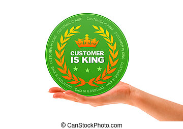 Hand holding a Customer is King icon on white background.