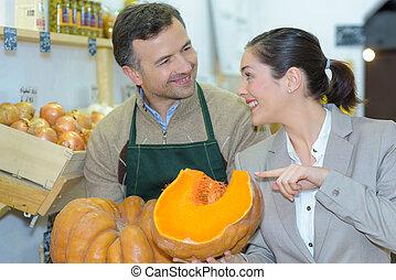 Customer looking at pumpkins