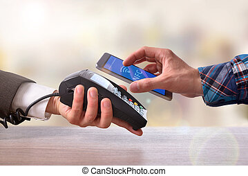 Customer paying a merchant with mobile phone nfc technology...
