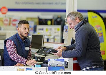 customer paying at a warehouse store