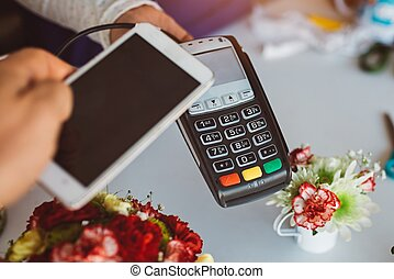 Customer paying contactless with phone