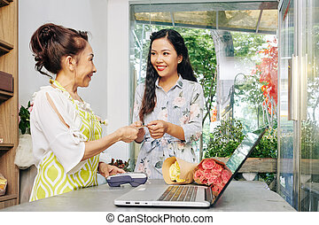 Customer paying for flowers