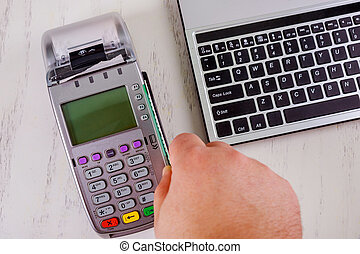 Customer paying with contactless card payment in store a...