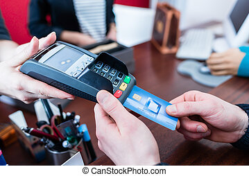 Customer paying with credit card in shop