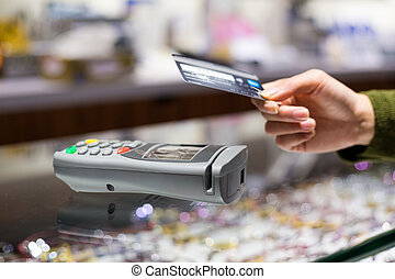 Customer paying with NFC technology by credit card