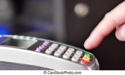 Customer paying with NFC technology by mobile phone on...