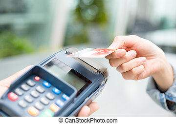 Customer paying with NFC technology