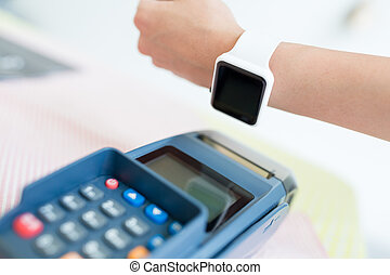 Customer paying with NFC technology with smart watch
